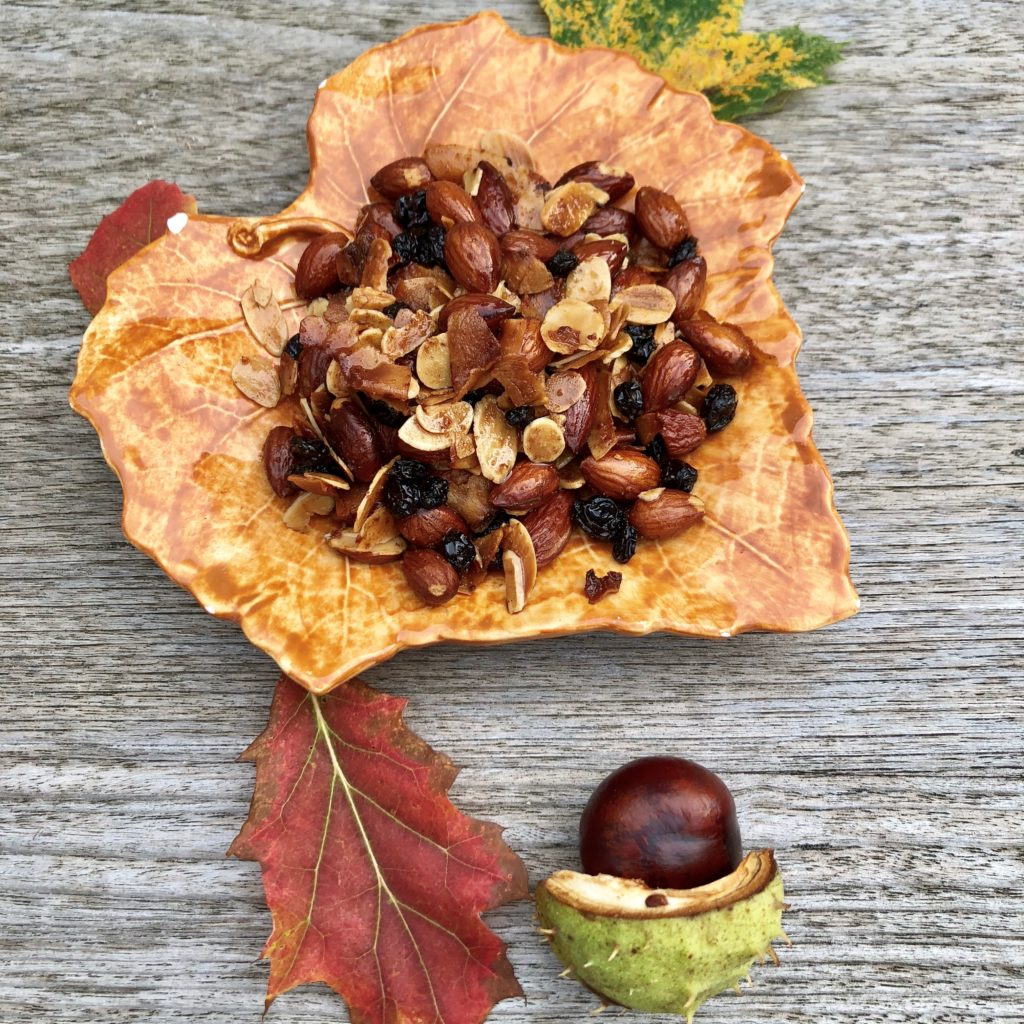 Crunchy bits for autumn cravings! brown plate on table with chestnut